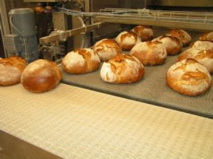 Artisan bread coming out of the oven