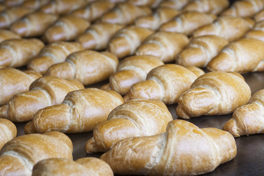 Baked Croissants Group On The Production Line
