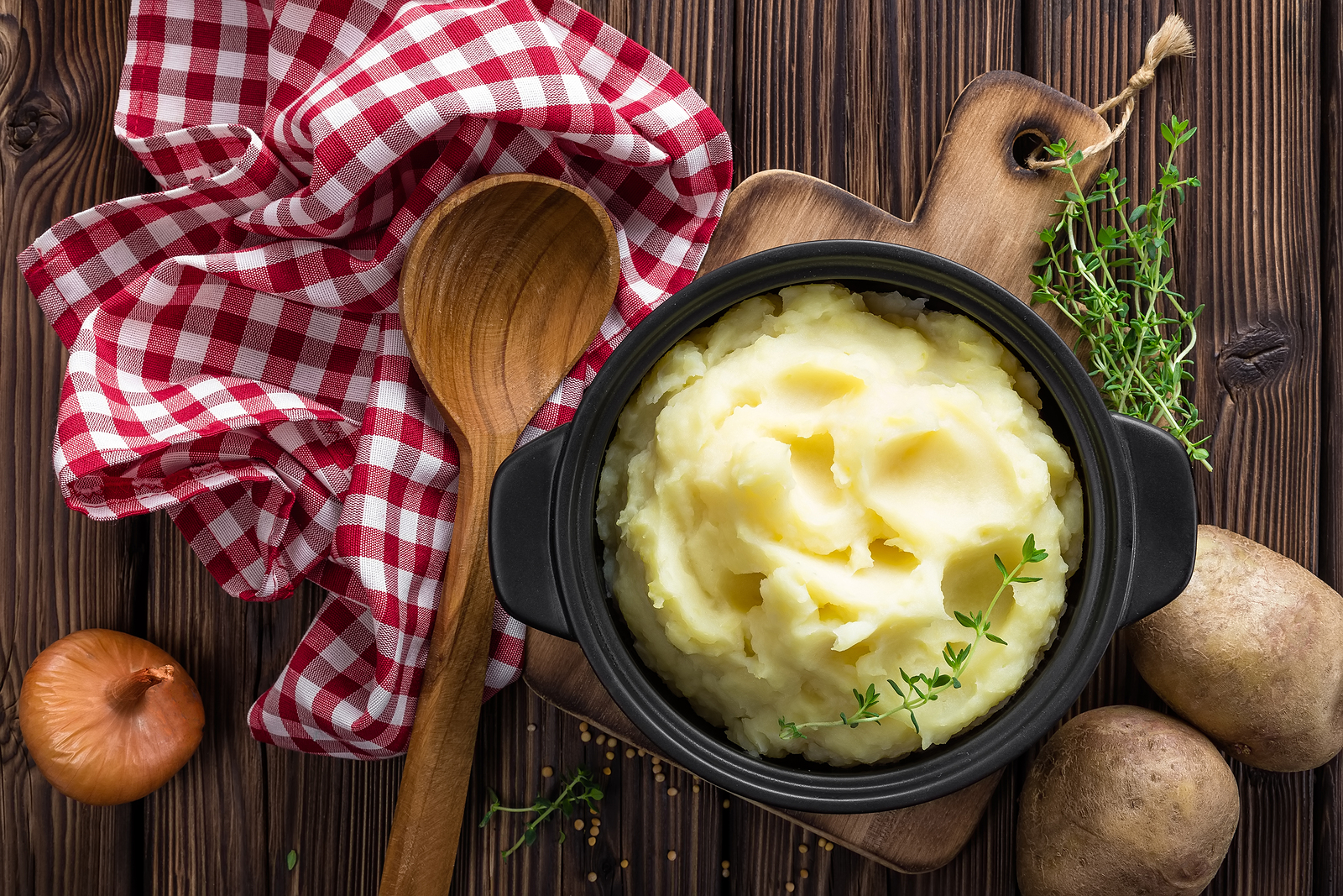 cooked mashed potato in a bowl on table