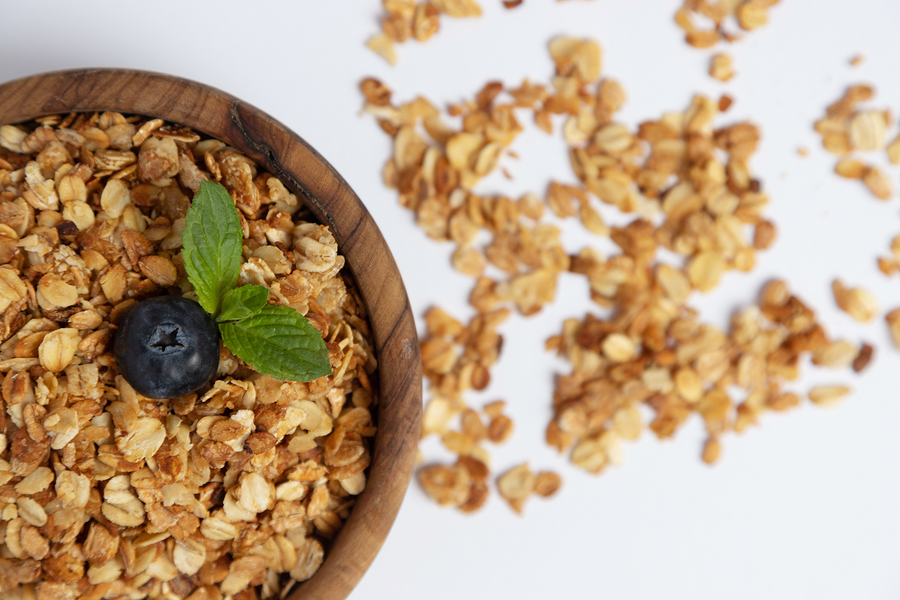 Top View On A Wooden Bowl With Homemade Granola Or Granola With