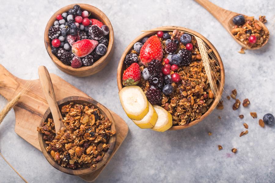 Granola Bowl. Morning  Granola, Fruits, Berries In Bowl On Grey